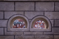 Aerial view of Cesky Krumlov old town through stone windows of f Royalty Free Stock Image