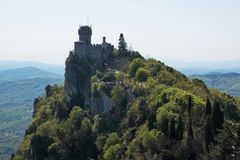 Aerial view of Cesta and The Montale on the cliff edge on Mount Titano royalty free stock photo