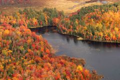 Aerial View of the changing fall colors of New England. The natural beauty of the lakes rivers and trees of Maine, New England, during the spectacular changing Stock Images