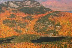 Aerial View of the changing fall colors of New England. The natural beauty of the lakes rivers and trees of Maine, New England, during the spectacular changing Stock Photo