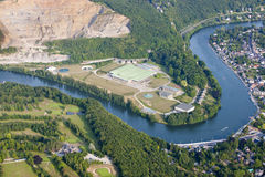 Aerial View : Channeling site along a river. Aerial View : Channeling site along a nice curved river close by a big quarry Stock Photos