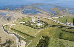 Aerial view of Chassiron lighthouse at low tide royalty free stock photo