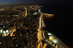 Aerial view of Chicago at night along lake Stock Photos