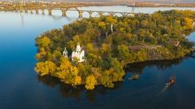 Aerial view of Christian Church on Monastic island on Dnieper ri. Autumn panoramic aerial view of Church on Monastic island on Dnieper river in Dnipro city stock photo