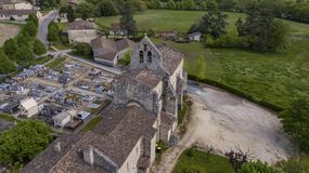 Aerial view of a church and cemetery in the French countryside, Rimons, Gironde stock photography