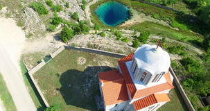 Aerial view of church next to the source of Cetina river, Croatia stock video footage