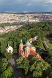Aerial view of a church at the Petrin Hill in Prague. View of Baroque and Gothic style Church of St. Vavrinec Lawrence at the Petrin Hill and beyond in Prague Royalty Free Stock Photos