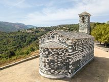 Aerial view of the church of San Michele de Murato, bell tower and apse. Corsica, France Stock Image