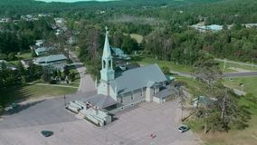 An aerial view of a church on a sunny day stock video footage
