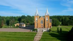 An aerial view of a church on a sunny day stock footage