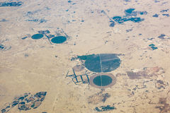 Aerial view of circular fields in the desert Royalty Free Stock Photo