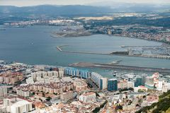 Aerial view on city and airport runway of Gibraltar and Spanish La Linea town on a background. Aerial view on city and airport runway of Gibraltar and Spanish Stock Images