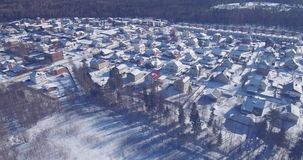 Aerial view of city area with low-rise houses in winter. Aerial view of the city area with low-rise houses in sunny winter day stock video footage