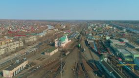 Aerial view of the city. The building of the railway station. Train depot with trains. stock video