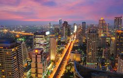 Aerial View of City Building beside Sathorn Street, Famous Busin. Ess Center of Thailand, with Skytrain and Traffic at Twilight time or Dusk Royalty Free Stock Image