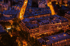 Aerial view of city buildings in Paris at night Stock Photos
