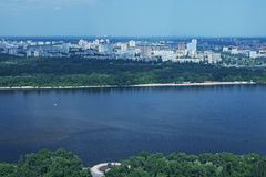 Aerial view of the city buildings, private houses, Dnieper River and bridges from Monumental statue Mother Motherland. Aerial view of the city buildings, Dnieper Stock Photos