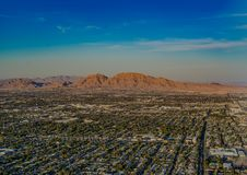 Amazing city and desert blend with blue sky stock photography