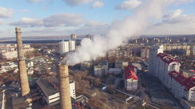 Aerial view of city districts with pipes factories, of which there is smoke stock video