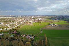 Aerial view of a city and farm fields Stock Image