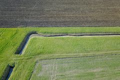 Aerial view of a city and farm fields Royalty Free Stock Photos