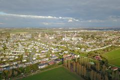 Aerial view of a city and farm fields Royalty Free Stock Image