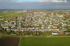 Aerial view of a city and farm fields Stock Photo