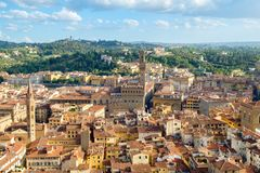 Aerial view of the city of Florence including the Palazzo Vecchio. And the nearby tuscan hills Royalty Free Stock Photos