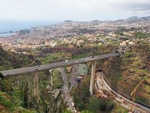 An aerial view of the city of funchal in madeira with a bridge carrying the vr1 motorway crossing the valley and construction work. On new reads visible royalty free stock images