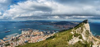 Aerial view on city of Gibraltar from Upper Rock Natural Reserve: on the left Gibraltar town and bay, La Linea town in Spain. And Mediterranean Sea on the right royalty free stock photo