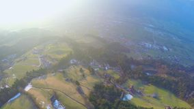 Aerial view, city in green valley at mountain bottom, environmental protection. Stock footage stock video