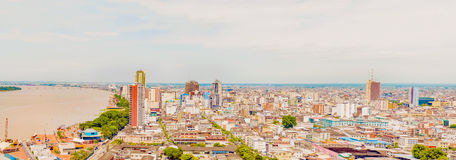 Aerial view at the city of Guayaquil, Ecuador. Guayaquil, Ecuador - April 16, 2016: Aerial view at the buildings and the river at downtown Guayaquil in Ecuador stock photo