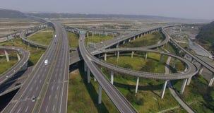 Aerial view of city highway interchange with bridge road stock footage