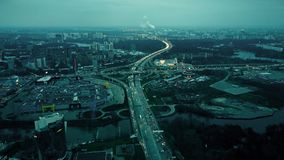 Aerial shot of big city highways intersection. Huge traffic jams near shopping malls in the evening rush hour Royalty Free Stock Image