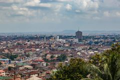 Aerial view of the city of Ibadan Nigeria with the Cocoa House, the tallest building in the distance. Aerial view of the city of Ibadan Nigeria as seen from the royalty free stock images
