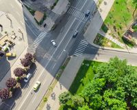 Aerial view of city with intersection and car traffic. Romania Stock Photography