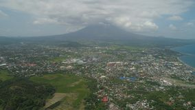 Legazpi city in the Pihilippines, Luzon. Aerial view city Legazpi in background Mayon volcano. Tropical landscape city near volcano on seashore, Philippines Royalty Free Stock Photography