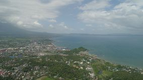 Legazpi city in the Pihilippines, Luzon. Aerial view city Legazpi in background Mayon volcano. Tropical landscape city near volcano on seashore, Philippines royalty free stock images