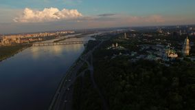 Aerial view city panorama. Architectural monument christian temple in summer. Aerial view city panorama from bird above. Drone view river crossing modern city stock video