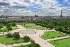 Aerial view on city park and Eiffel Tower in Paris. Aerial view on city park near Louvre Royal Palace and Eiffel Tower in Paris, France Stock Photo