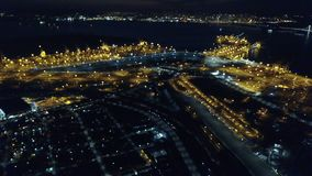 Aerial View of Oakland, California, Port at Night. An aerial view of the city and port of Oakland, CA. The city is known for its sustainability practices and stock video