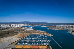 Aerial view of the city of Portimao, in Algarve, with the Marina in the foreground and the Monchique mountain in the background. Concept for travel in Portugal Royalty Free Stock Photo
