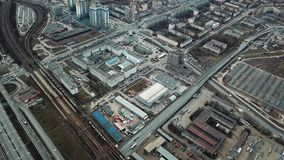 Aerial view of the city, roads, houses, railway and other buildings. Panoramic image. Aerial view of the city, roads, houses, railway and other buildings stock footage