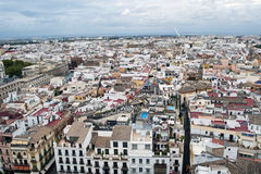 Aerial view of the city of Seville. Are the roofs of the buildings next to Each Other, it is a cloudy day the photo is taken from the tower of the Giralda Royalty Free Stock Photography