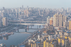 Aerial View of a City Skyline and a Bridge over the Water Stock Images