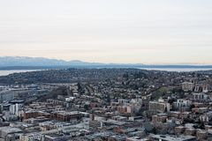 Aerial view of City skyline and mountains Royalty Free Stock Photos
