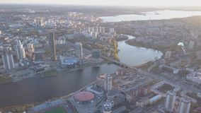 Aerial view city and sports palace. Modern city in sunset, aerial view of cityscape. Urban landscape stock footage