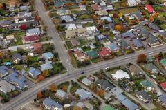 Aerial view of city suburbs. Aerial view of houses and roads in residential city suburbs Royalty Free Stock Photos