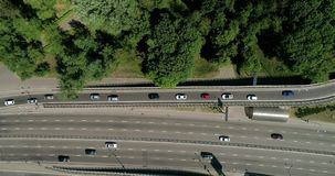 Aerial view of a city traffic on the bridge. Aerial view of a turbine road interchange in Kiev. Aerial Drone Flight View of freeway busy city rush hour heavy stock video footage