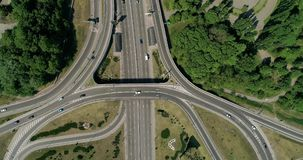 Aerial view of a city traffic on the bridge. Aerial view of a turbine road interchange in Kiev. Aerial Drone Flight View of freeway busy city rush hour heavy stock footage